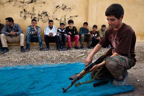 """""""Academia militar"""" en Tlaleen en el norte de Siria Aleppo la provincia. AFP PHOTO / JM LÓPEZ"""